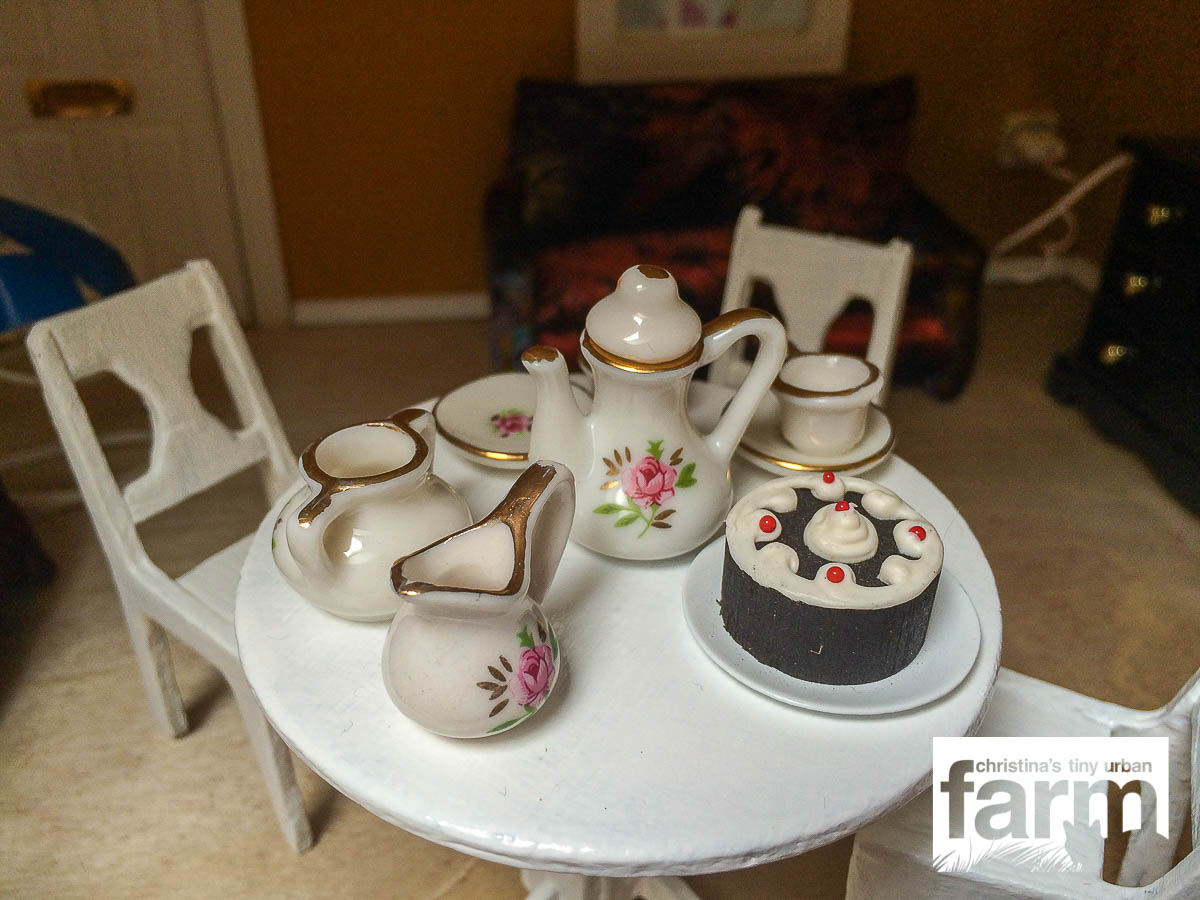 Dollhouse coffee table with black forrest cake
